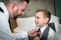 Wedding-Groom helping son with his tie